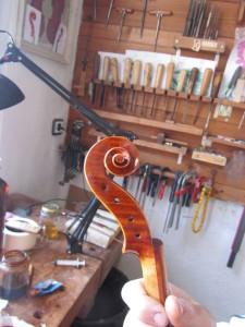 violin scroll_left